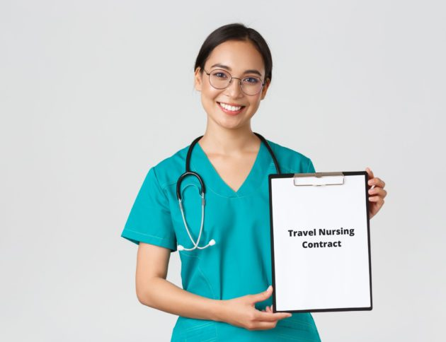 Travel nurse holding board with nursing contract