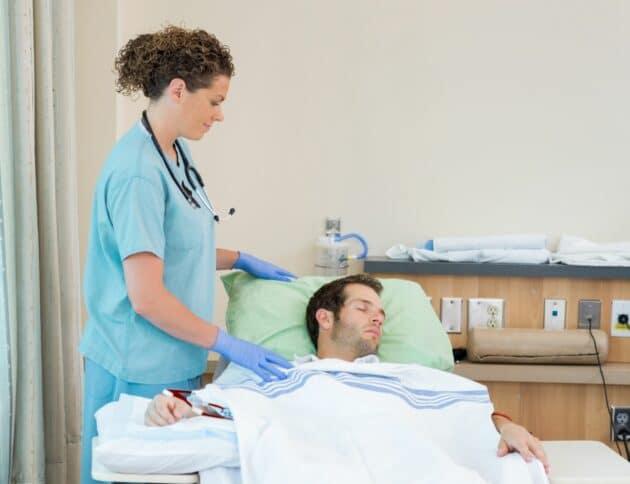 nurse on her dialysis nursing shift taking care of patient