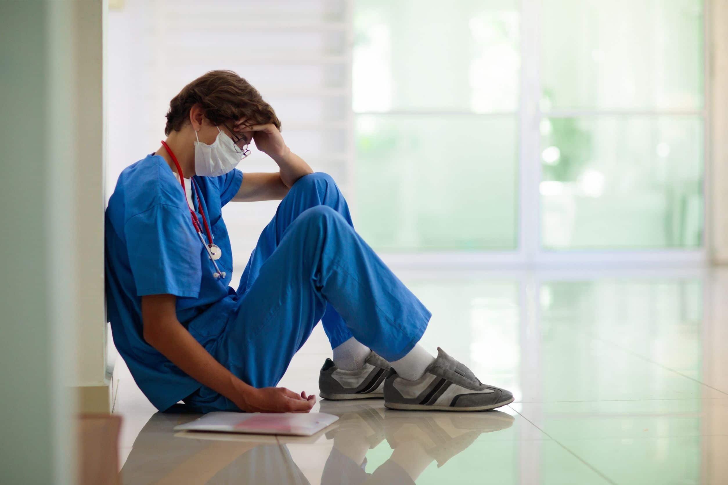 healthcare worker experiencing nursing burnout and feeling tired