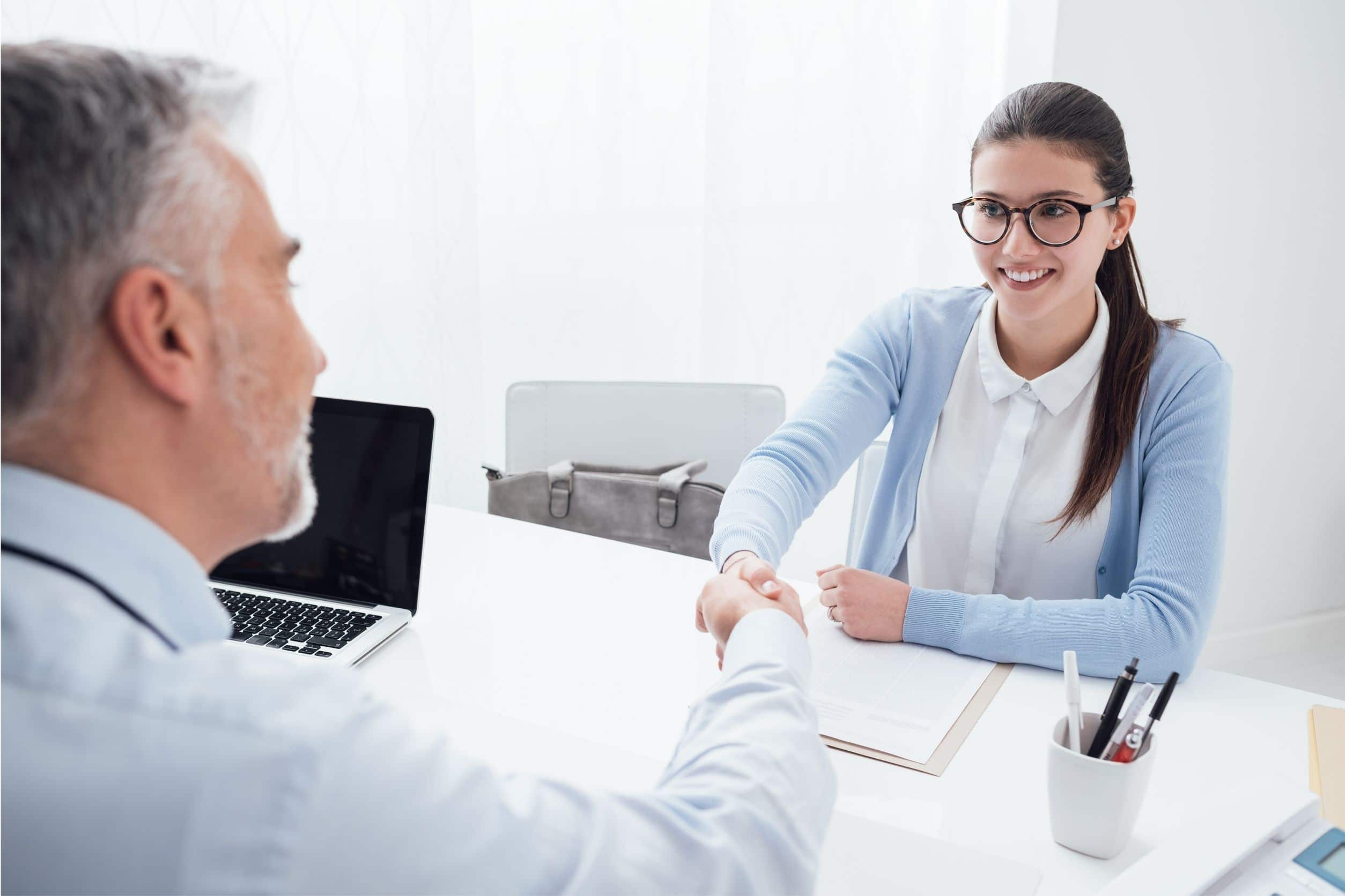 Young woman accepting travel nurse job after interview is over